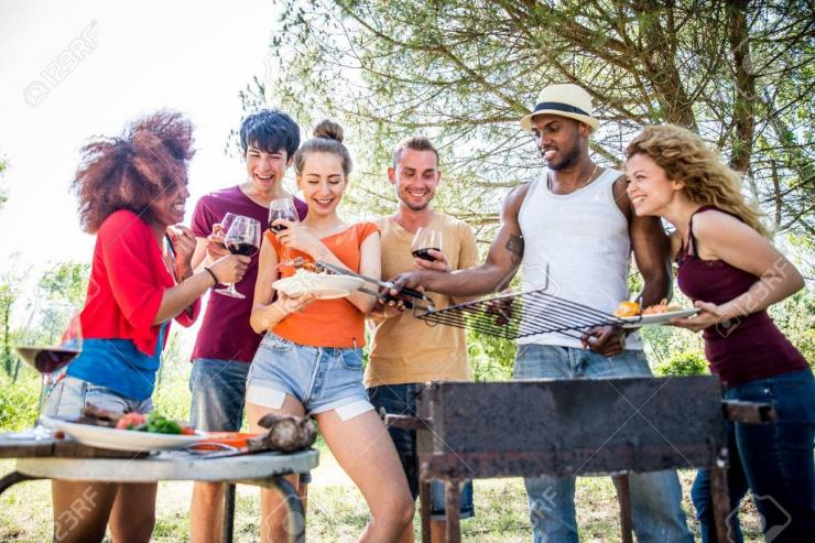 https://www.123rf.com/photo_79816487_happy-multiracial-friends-having-fun-at-picnic-barbecue-garden-party.html