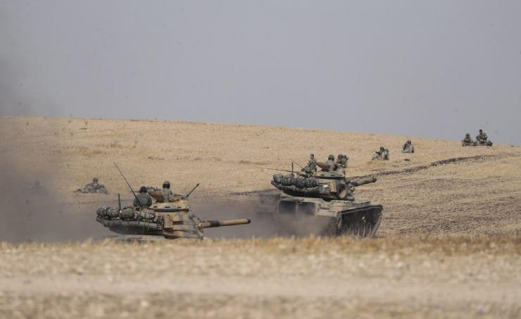 Turkish tanks and troops stationed near Syrian town of Manbij, Syria, Tuesday. Oct. 15, 2019..(Ugur Can/DHA via AP)