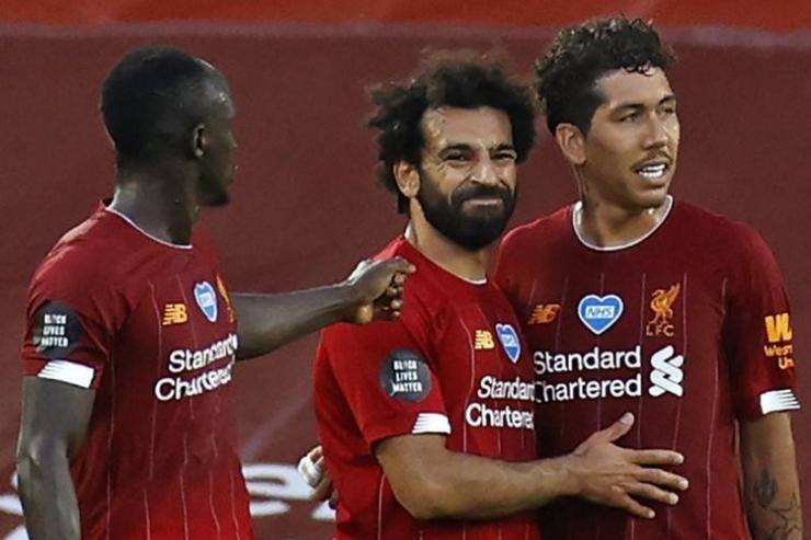 Dari kiri: Mane, Salah, dan Firmino. Gambar: AFP/Phil Noble via Kompas.com